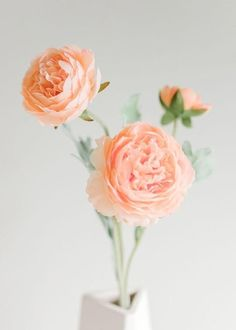Give your DIY wedding bouquets and centerpieces soft blush tones with pretty peach pink ranunculus. Budget savvy artificial silk flowers at Afloral.com.