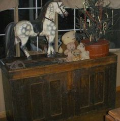Like this dapple gray horse on old wood dry sink.