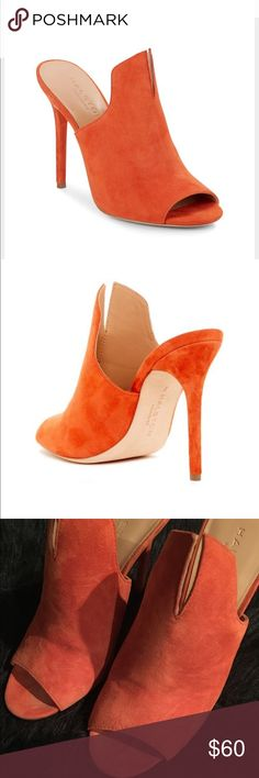 Halston Notched Suede Carmen Orange Mules/Heels Halston Notched Suede Carmen Orange Mules! These shoes are used! Left heel has a black scuff as shown in photo!! Otherwise in good condition!! I purchased these shoes New at Nordstrom for $150!! Size: 7 Halston Heritage Shoes Heels