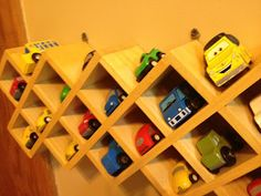Garage sale spice rack turned into a toy car rack.. Totally gonna do this for my Hot Wheel collection!