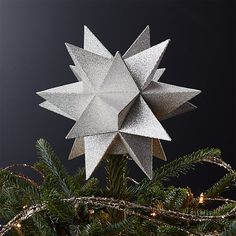 Coated with high-shine glitter, our three-dimensional Moravian star tree topper adds an extra bit of shimmer to the holiday tree. Lightweight yet sturdy, the card stock topper nestles right onto tree branches via a two-inch hole on the bottom.