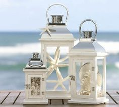 Great lanterns with shells and starfish inside, LOVE: great for the guest signing table for top of stars at captains deck. Guest book table.
