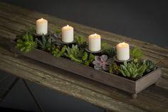 For a planter that easily doubles as a romantic centerpiece, consider this Vagabond Vintage four candle planter.