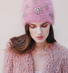An angora beanie with a twist at the top - this style has a little more volume at top than a traditional beanie. It is embellished with 6 sparkling jeweled embroideries. A gorgeous piece - so soft and lush! And all of our angora is Italian and ethically sourced. We ship worldwide! Orders ship within 3-5 business days. Please email shop@jenniferbehr.com or call 718-360-1875 to request expedited shipping. We are a small team and are happy to answer your questions 10am - 6pm, Monday - Friday…