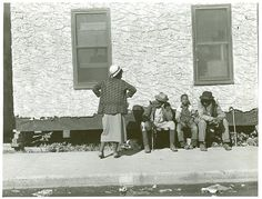 """In front of city hall, Belle Glade, Florida"" January 1939 Farm Security Administration Collection. / Florida. / Marion Post Wolcott."