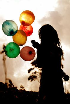 Beautiful silhouette photo with a colorful contrast of balloons.