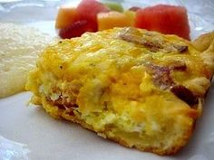 "This is an easy breakfast casserole that you can whip up on a weekend morning for a delicious breakfast or brunch. Brandon had been asking me to make his aunt's ""breakfast pizza"" for years. I'm not..."