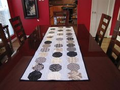 Looking for quilting project inspiration? Check out Snowball Table Runner by member Heather K.