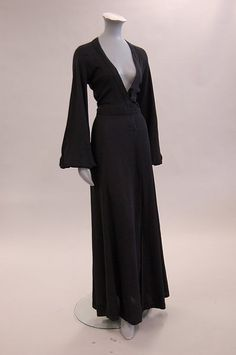 Ossie Clark black moss crepe wrap-over evening gown with key-hole back opening, bishop sleeves, early 1970s.