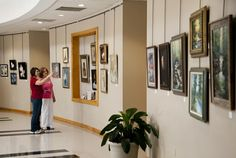 Jenny Johnson (right), Director of the Swain County Center for the Arts conducts a tour of the Center's Gallery at Swain County High School in Bryson City, NC.