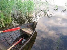 Wooden boat in the home lake