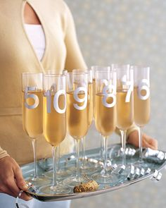 Countdown Toast -- For a fun twist on the New Year's Eve countdown, pass Champagne in glasses marked with numbers representing those anticipated last 10 seconds. Self-stick numbers can be found in office- and art-supply stores. On January 2, either peel off numbers (use a cotton ball and adhesive remover to wipe away residue) or save the flutes for next year.