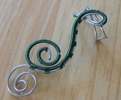 Ear cuffs are often associated with alternative fashion, including Goth and steampunk.  But can really be worn by anyone.
