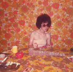 Inez's rules for a successful round of solitaire: Mandatory - tube top, home perm, & cigarettes. Optional - Matching wallpaper & tablecloth.