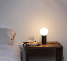 Turn On is a table lamp by Joel Hoff for Hay. Anodized aluminum base in four finishes: black, green, orange and natural aluminum and diffuser in blown glass.  Turn On lamp is a playful and well-balanced proportions table lamp.