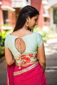 Ready to shop blouses House Of Blouse Another cooly combined number! A floral blouse with a slim plain silk yoke and floral piping details. Don this beauty for a simply chic appeal. Any saree in one of the floral colours, or even a black saree to make Saree Blouse Patterns, Saree Blouse Designs, Indian Attire, Indian Outfits, Indian Wear, Saree Styles, Blouse Styles, House Of Blouse, Choli Designs