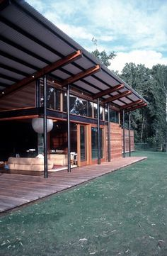 Modern pole barn open deck two french doors one to south one to west Decks to match High windows deck is same material as inside floor - Trex?