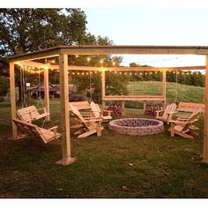 Fire pit with framing for porch swing surround. Could even mount hammocks between posts as well!