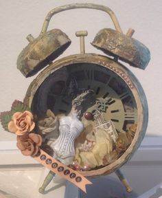 Altered Tim Holtz Assemblage Clock - Scrapbook.com - Embellish and distress Tim Holtz Assemblage clock to make a beautiful shadow box.