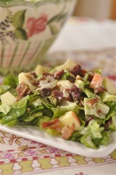 Autumn Apple Salad @yourhomebasedmom.com. Ingredients: Romaine & baby spinach 1/2 C Craisinets 1 C chopped pecans 1 apple, diced 6 slices bacon, fried and crumbled 1/2 C poppy seed dressing 1/2 C balsamic vinaigrette