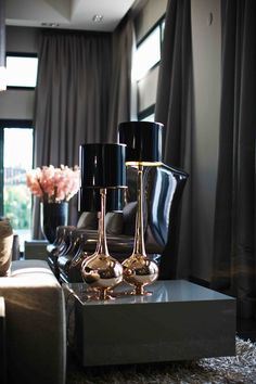 I love the cluster of lamps on one end table. Eric Kuster Metropolitan Luxury Book II, Photo's by Paul Barbera.