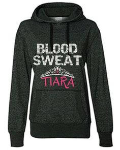 BLOOD, SWEAT, TIARA! Whether you are a running Princess, Running Diva or just love this motivational saying; you'll love wearing this comfy Graphite grey hoodie. The Black material has silver metallic sparkles in it plus the words Blood and Sweat are printed in silver metallic glitter ink. The word Tiara is in Pink Glitter ink. So if Glitter and Running are your fav's; you'll love showing off your glamour and glitz in this hooded sweatshirt.