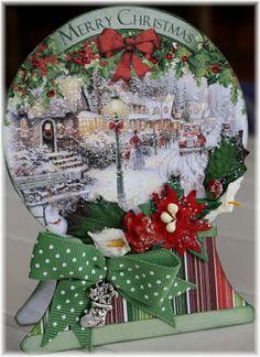 Use an old Christmas card to create the scene in the snowglobe. Cute idea.