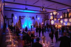 Perfection for this #Holiday #office #party. Love the #snowflake patterned #gobos and blue #uplighting. Nice photo via #themers