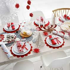 Festive table decorations for Christmas in red and white