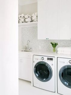 An all white laundry room gives this space a fresh, crisp feel to it. White Laundry Rooms, Laundry Room Inspiration, Laundry Room Design, Ship Lap Walls, New Construction, Living Room Designs, Living Spaces, Custom Homes, Home Appliances