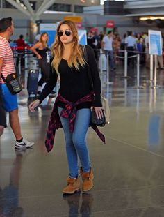 0f59a925e679 JFK Airport Who  Khloe Kardashian Wearing  Timberland boots. Kardashian  GirlsKardashian DressesKhloe Kardashian StyleKardashian ...