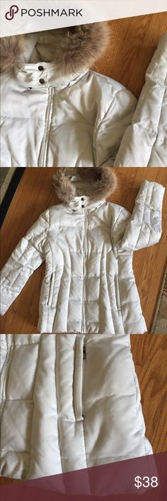 Love this coat!  Fur hood, quilted for winter!  ☃️ Lovely white puffer coat, faux fur hood, side pockets, inner zip pocket for your phone.  Snaps at neck, detachable zip hood.  Small mark on front, as shown, not very noticeable.  Warm and cute. a.n.a Jackets & Coats