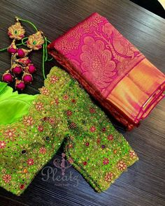 Main pakka Can not stop admiring this jewel blouse! Love all the colours! Stunning pink color pattu saree and parrot green color designer blouse with floral design hand embroidery saree work. Wedding Saree Blouse Designs, Pattu Saree Blouse Designs, Fancy Blouse Designs, Wedding Sarees, Wedding Dresses, Blouse Back Neck Designs, Sari Bluse, Stylish Blouse Design, Hand Work Blouse Design