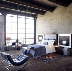 more of this loft that I want-- love it with the dark wood floors. and that chair is like a fairy-tale come true for me.