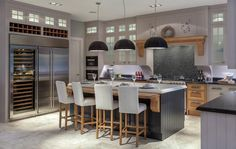 Lilac kitchen with metal fridge and wine cooler
