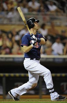 Joe Mauer #7 of the Minnesota Twins hits a triple against the Seattle Mariners during the seventh inning on August 29, 2012 at Target Field in Minneapolis, Minnesota. The Twins defeated the Mariners 10-0.