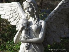 Bastrop, Texas..small baby, now forever asleep in the arms of an angel.  How very sad. This sculpture is so moving.