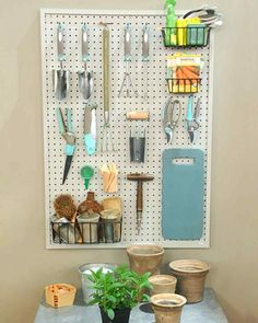Shed Plans - I usually hate Martha Stewart, but I do covet the organization if these tools and bench. Im totally stealing the idea for my potting/gardening area. Now You Can Build ANY Shed In A Weekend Even If You've Zero Woodworking Experience! Pegboard Storage, Shed Storage, Garage Storage, Hanging Storage, Tool Pegboard, Craft Storage, Outdoor Storage, Small Garden Tool Storage, Hang Pegboard