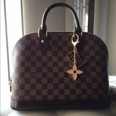 Louis Vuitton , ALMA Brand new , used twice , comes with dust bag And lock pouch . Hair line scratch on the gold lock . Perfect condition over All . Interior brand new . The LV  charm NOT included in pricing . Louis Vuitton Bags