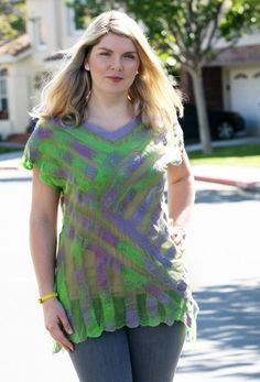 FASHION FELT * SUMMER FELT * FELTED TUNIC * FIBER ART * BRIGHT & LIGHT TOP * LOOSE SUMMER TUNIC This one of a kind handmade Nuno felted very bright colors tunic is very light. Made with bright green crushed silk - very light and transparent as a lining. It is inlaid with various color / size wool pieces decorated with natural raw fibers and arranged in an intricate pattern. This top is a truly wearable art and guaranteed to be one of a kind! Will fit US size 6 - 12 for a loose fit....