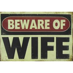 """Express your fun sense of humor with this Beware of Wife Tin Sign! Featuring a classic red, beige and black """"warning"""" sign style, this sign will make a hilarious addition to your man cave, shop, or ga"""
