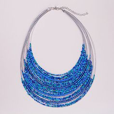 Blue Beaded Multistrand Necklace | World Market.  Ask mom to make with more triangular shape, fewer beads on upper strands