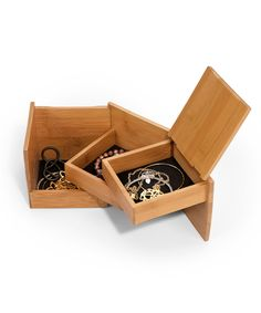 This handsome bamboo jewelry box swivels to form a perfect cube. Easy to store and great for keeping valuables tucked out of the way.