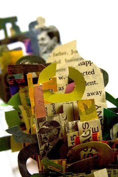 Idea:  make letters out of book pages: letter stands for each person/activity/word