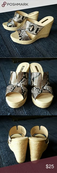 """Jennifer Lopez Espadrille Wedge Sandals Flattering slip-on snake skin design wedge sandals! Brand new with tag! Lightly padded foot bed. 4"""" wedge. Size 8 1/2 womens. There is a super small scrape that can be seen in the last photo. Not noticeable during wear :) There is also a small gray mark near the left heel. It is so light, it didn't show up in the 4th photo ;) Comment with any questions you may have. Bundle and save :)  Don't be afraid to make an offer! :D Jennifer Lopez Shoes Wedges"""