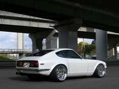 240z what a car clean and sophisticated with a hand full of stance and some wheel stuff for good messier