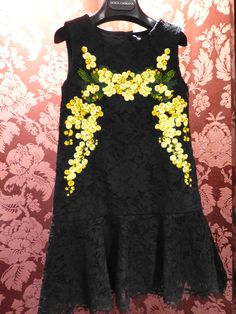 Sicilian inspired floral embroidery on black lace for spring 15 kidswear at Dolce & Gabbana