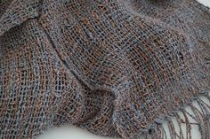 This luxurious, hand woven scarf is the perfect choice for that little black…