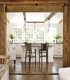 The owner of this home tore out the dropped ceilings, and stripped plaster and lathe down to the posts and beams—opening up the room with wider doorways and additional windows. She also enlarged the opening from the keeping room to the kitchen, adding salvage-yard antique posts where needed.