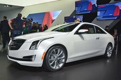 2015 @Cadillac ATS Coupe prepares to fight BMW 4 Series. http://aol.it/1m0JHhq #NAIAS #BMW